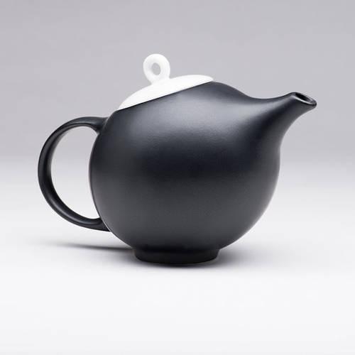 Elegant black matte teapot with white lid